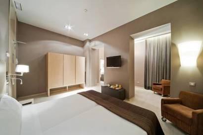 Habitación familiar  del hotel Actual. Foto 1