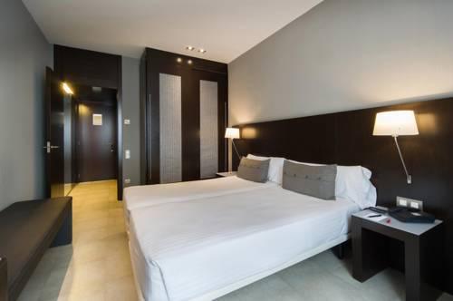 Habitación doble dos camas separadas del hotel Actual. Foto 1
