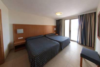 Habitación doble dos camas separadas del hotel Neptuno. Foto 1
