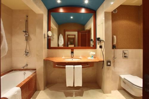 Habitación doble dos camas separadas del hotel Lopesan Costa Meloneras Resort, Spa and Casino. Foto 1