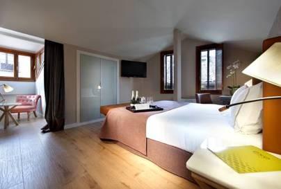 Habitación triple  del hotel Exe Casa de Los Linajes. Foto 2