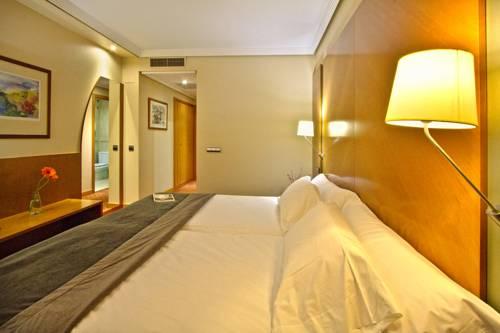 Habitación doble dos camas separadas Confort del hotel Silken Juan de Austria. Foto 2