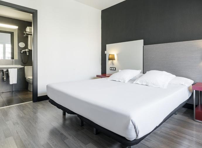 Habitación cuadruple  del hotel Ilunion Romareda