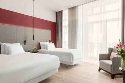Habitación familiar  del hotel NH Amsterdam Grand Hotel Krasnapolsky. Foto 1