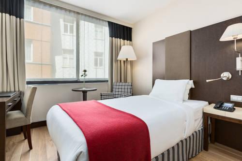 Habitación individual  del hotel NH Brussels Louise. Foto 2