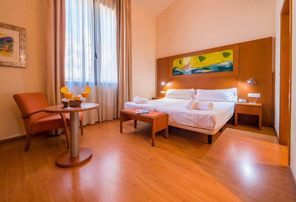 Habitación individual  del hotel Checkin Valencia