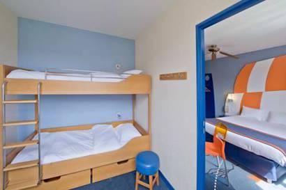 Habitación Familiar hasta 4 personas del hotel Explorers at Disneyland París. Foto 1