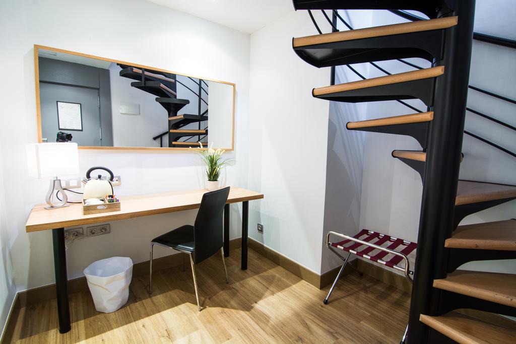 Habitación doble Superior Duplex con bañera de hidromasaje del hotel Petit Palace Plaza del Carmen. Foto 2