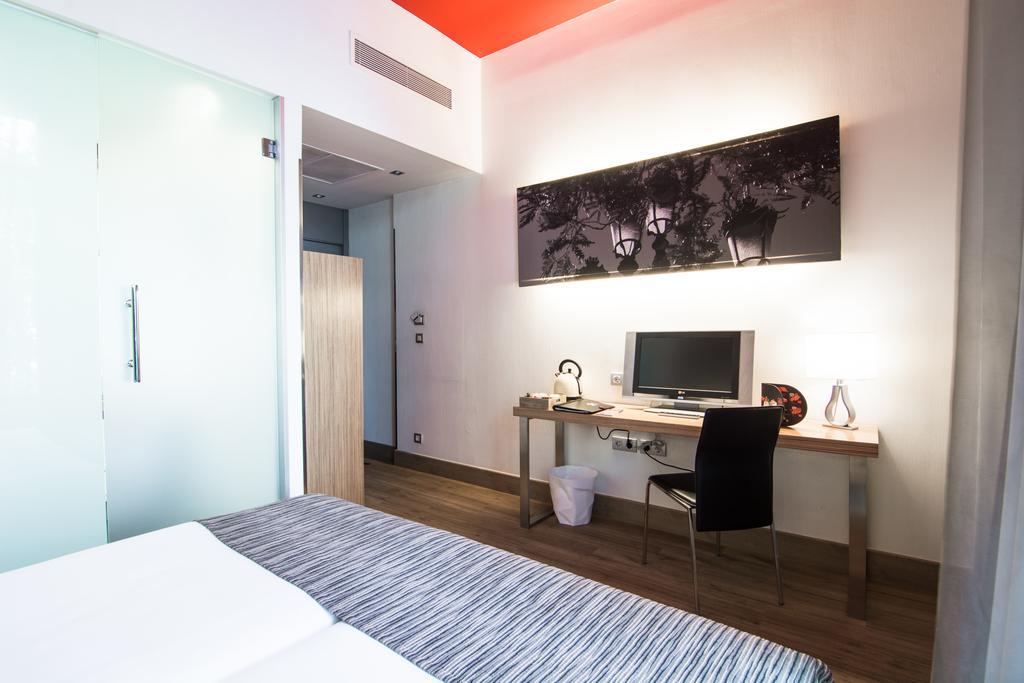 Habitación doble dos camas separadas del hotel Petit Palace Plaza del Carmen. Foto 1