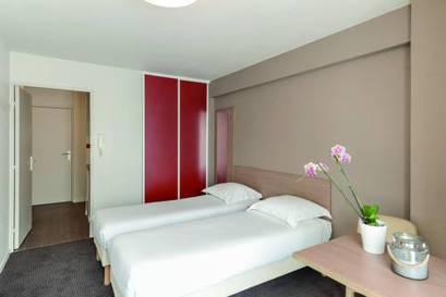 Estudio dos camas separadas del hotel Appart City Paris La Villette