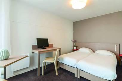 Estudio dos camas separadas del hotel Appart City Paris La Villette. Foto 1