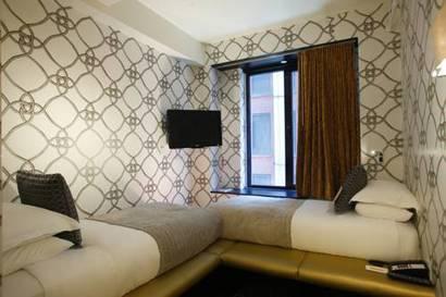 Habitación doble dos camas separadas del hotel Room Mate Grace. Foto 3