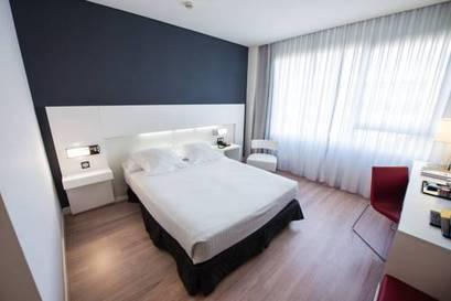 Habitación doble  del hotel Axor Feria