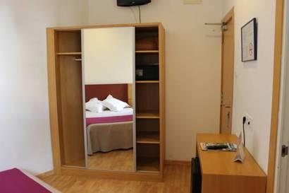 Habitación doble  del hotel Amic Colon. Foto 2